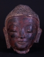 Antique Buddha head from Burma made from lacquer